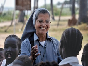 Sister Ninet D'Costa greets students in Detang, a small village across the Upper Nile River from Malakal, Southern Sudan, Nov. 22. Sister D'Costa, a member of the Daughters of Mary Help of Christians from India, came to the war-torn African country under the auspices of Solidarity with Southern Sudan, an international network of Catholic groups supporting Southern Sudan with educational personnel and prayer. (CNS photo/Paul Jeffrey) (Dec. 10, 2010) See SUDAN-BORDER Dec. 10, 2010.